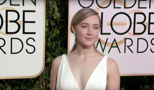 Saoirse Ronan defiantly, and elegantly, posing to her left despite yells to pose to the right.