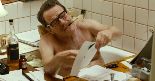 Bryan Cranston, as Dalton Trumbo writing in bathtub