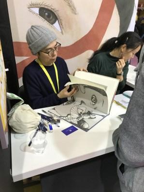 Тайё Мацумото впервые держит в руках каталог собственной выставки…