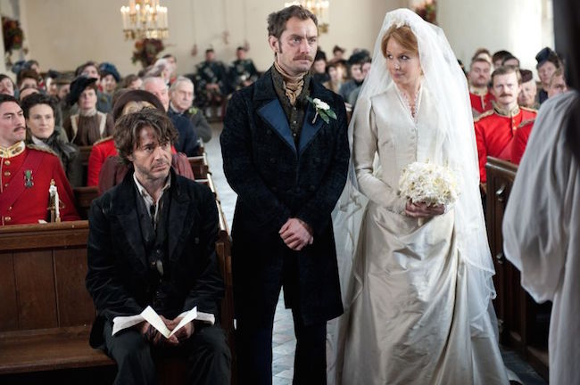 Holmes (Robert Downey, Jr.), Watson (Jude Law), and Mary (Kelly Reilly) at the wedding