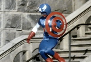 Captain America in action, sliding down a bannister