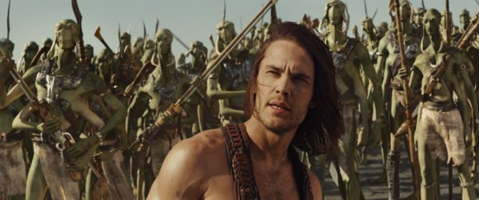 Taylor Kitsch as John Carter, with Tharks