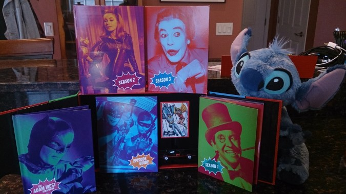 All the goodies in the Batman: The Complete Series box -- three seasons on Blu-ray plus the car, replica trading cards, a hardcover picture scrapbook, and an episode guide