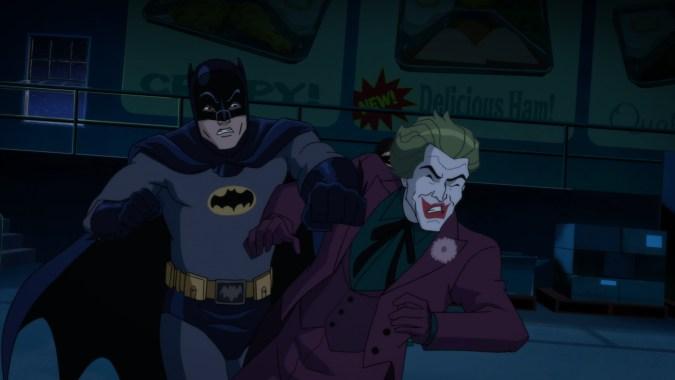 Batman punches the Joker in Batman: Return of the Caped Crusaders