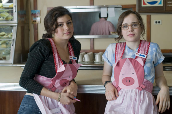 Alia Shawkat and Ellen Page working at the Oink Joint