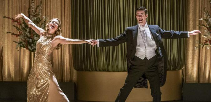 Melissa Benoist and Grant Gustin in the Flash/Supergirl musical crossover episode