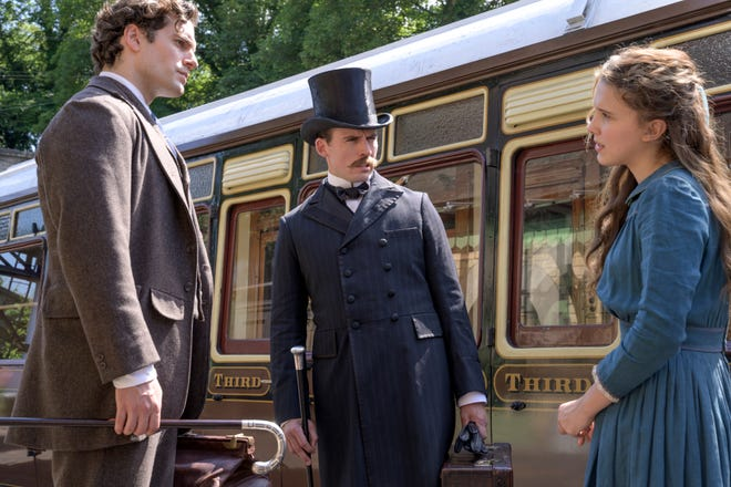 The Holmes siblings in Enola Holmes: Sherlock (Henry Cavill), Mycroft (Sam Claflin), and Enola (Millie Bobby Brown)