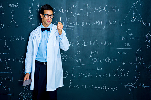 Scientist working on chemistry formulas