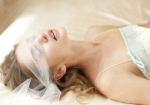 Beautiful woman wearing a sheer blindfold