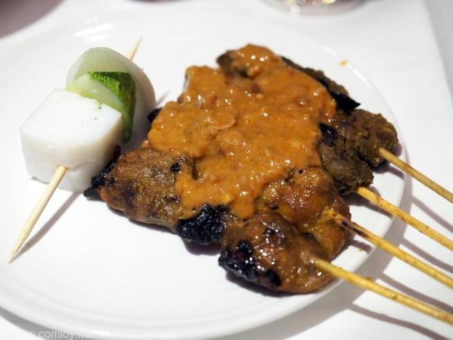 MALAYSIAN SATAY Charcoal hand-grilled chicken and beef skewers, peanut sauce and traditional accompaniments