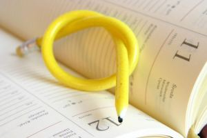 yellow, twisted pencil on a diary