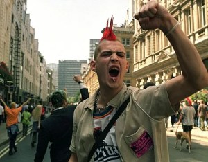 "LON08 - 19990618 - LONDON, ENGLAND; UNITED KINGDOM : A rioter shows hist fist in the City of London after a march to ""reclaim the streets"" turned violent, Friday 18 June 1999. The protest, which was called to mark the opening of the G8 sumit in Cologne, turned violent having seen a carnival-like morning with protesters involved in running street battles with riot police. AFP PHOTO EPA PHOTO AFP/SINEAD LYNCH"