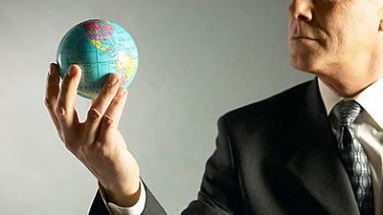 man holding globe of earth