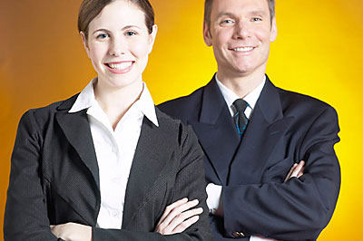 two business people smiling