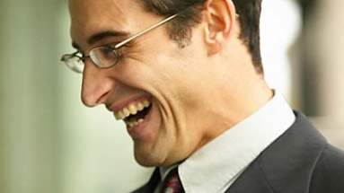 business man smiling and laughing