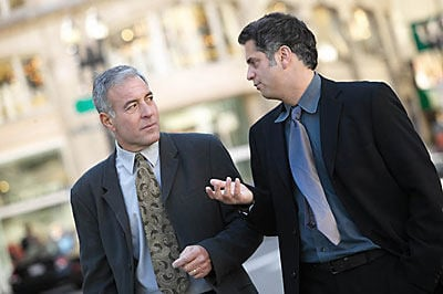 two business men walking and talking