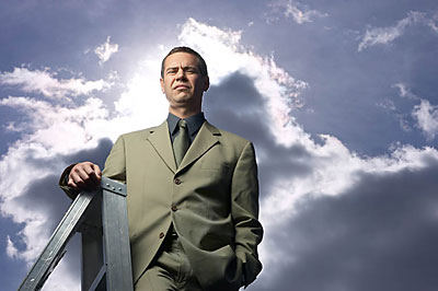 man standing on ladder