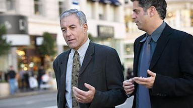 business men walking and talking
