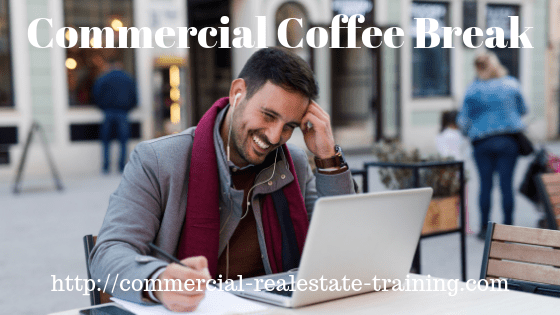commercial real estate agent at computer