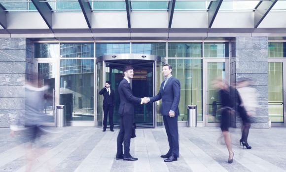 business men greeting and shaking hands