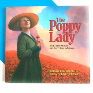 Image of veterans day book cover showing woman with a hat in a field of flowers