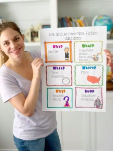 Julie holding a Common Core Reading Standards Anchor Chart