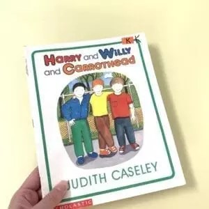 Cover of Harry and Willy and Carrothead showing three boys on the cover. One of the boys is disabled with a prosthetic hand.