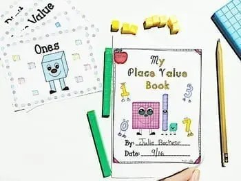 Student created Place Value Book cover with place value flashcards, pencil, and math counter manipulatives