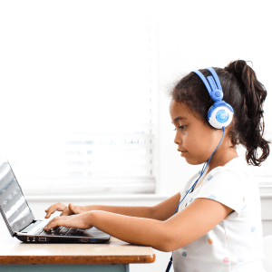 Student completes reading lesson on computer for distance learning.