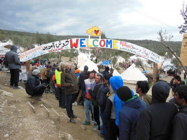An hour-long food line at a refugee encampment outside the Greek town of Moria, Lesbos island, on March 16, 2016
