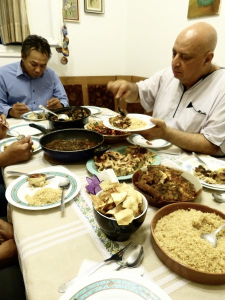 Stamou's husband Naim Elghandour, Chairman of the Muslim Association of Greece, loads his plate with food to break the Ramadan fast on June 29.