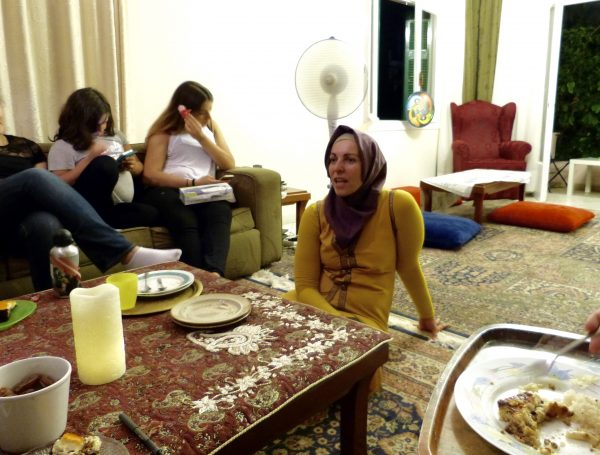 Anna Stamou sits in her living room in Athens on June 29. She is the Marketing Director of the Muslim Association of Greece, and one of a small population of Muslims in Athens.