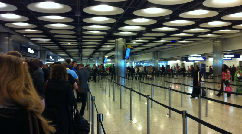People in an immigration queue.