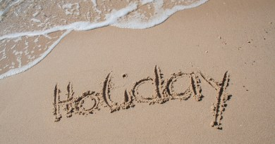 A sandy beach with the word holiday