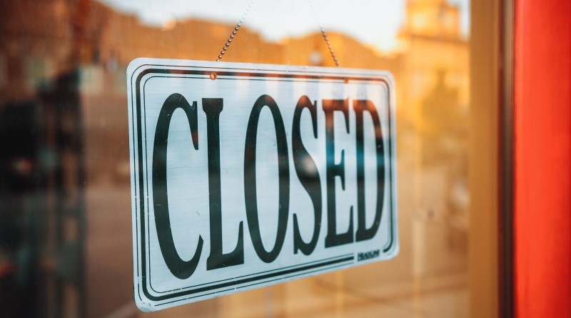 A closed store sign