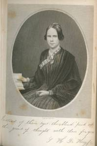 "Frontispiece, Helen Aldrich De Krofyt, A Place in Thy Memory. New-York, 1850. This pictures shows an engraved grayscale portrait with a printed facsimile of a handwritten caption beneath. The portrait depicts Helen Aldrich De Kroyft, a woman who is seated against a solid gray backdrop. Her eyes directly face the viewer, though her body is slightly angled to the viewer's left. Her dark hair is parted down the middle and loosely pulled back into a bun, so that the sides of her hair cover her ears. She wears a dark striped dress with a dark shawl and plaid, light-colored neckerchief loosely knotted at her neck. In her right hand she holds open a book resting on a table, while her left hand holds a small piece of dark fabric, possibly a handkerchief or a pair of gloves. The portrait is in a light grey oval frame, fixed to light sepia paper. The slanted, cursive handwritten text below the portrait reads: ""Instead of their eyes, the blind pick up the gems of thought with their fingers."" The third line of text in the bottom right corner: ""S. H. De Kroyft."" [End of description]"