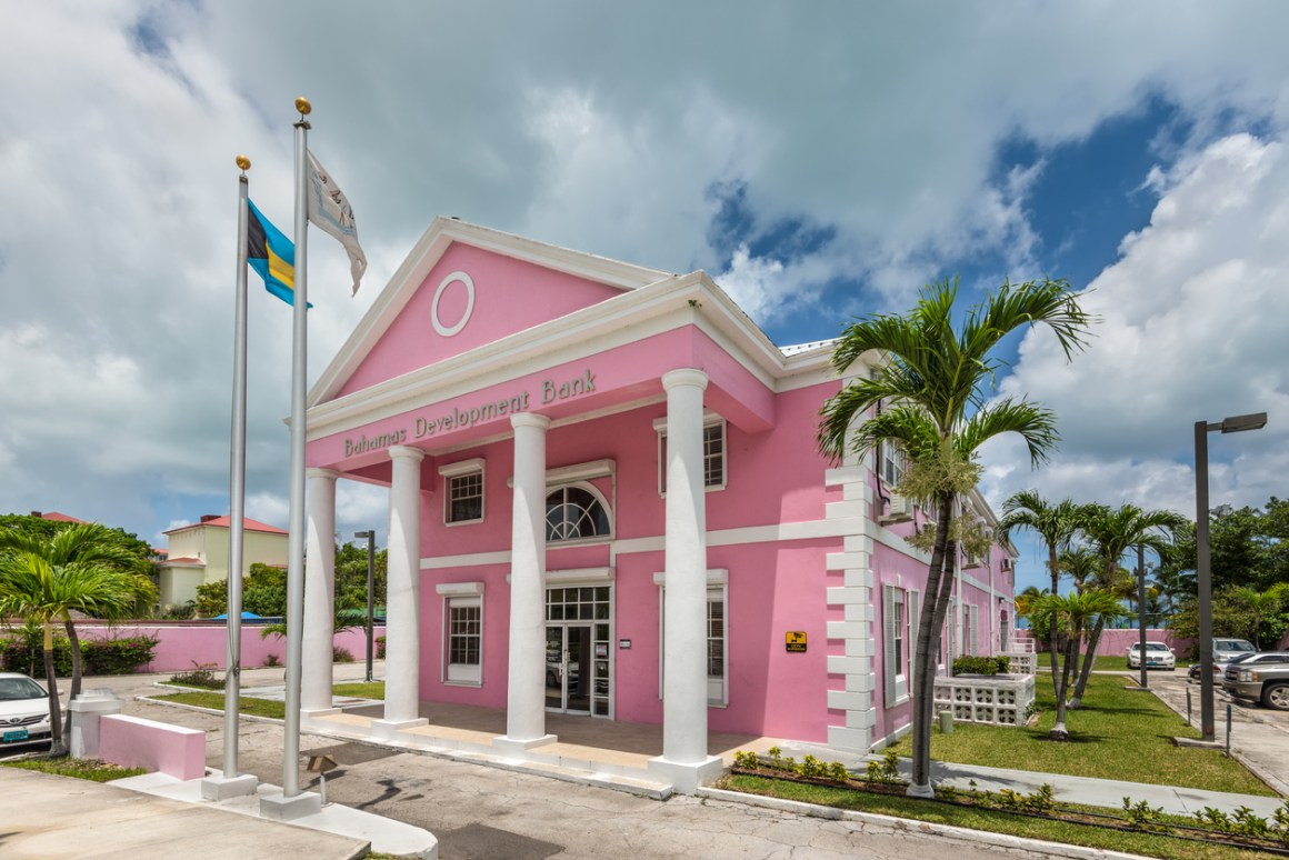 BDB Bahamas Development Bank in Nassau. A pink building with white columns.