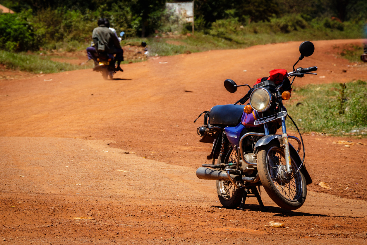 Electric Mobility in Kenya - Boda Boda, a motorcycle taxi, waiting for customers in a park.