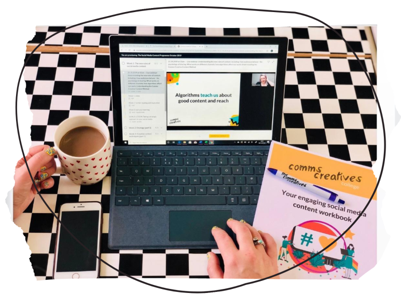 someone doing an online course on their laptop, with a coffee