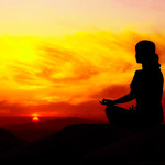 Silhouette of a beautiful Yoga woman in the morning