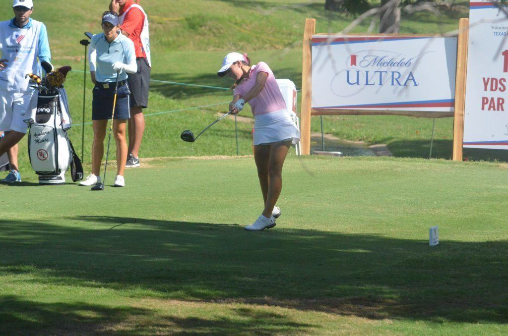 Knight puts her all into a drive off the No. 17 tee box.