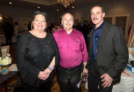 WINSTED, CT-020819JS01- Lauren DiMauro, Executive Director at Friends of Main Street, with board president Fran Delaney and Tim Van Deusen of Torrington, at the 13th annual Bubbles and Truffles chocolate and wine tasting event held Friday at the Crystal Peak Banquet Hall in Winsted. The event was hosted by the Friends of Main Street. Jim Shannon Republican American