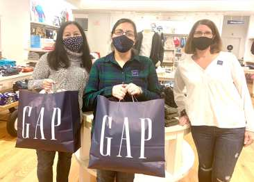 The Gap has sponsored Needy Fund children for the past several years. Carla Fernandes, Store Manager, (center) with Assistant Store Managers Sue Job and Kristen Cupola.