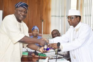 (R – L) Chairman of Council and Pro-Chancellor, Dr. (Barr.)Aboki Zhawa presenting a plaque of award to the Out-gone representative of Senate on Council and Dean, Post-graduate School, Professor Wilfred Alegbeleye