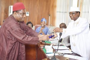 (R–L) Chairman of Council and Pro-Chancellor, Dr. (Barr.) Aboki Zhawa presenting a plaque of award to the Out-gone representative of Senate on Council, Professor Christain Ikeobi