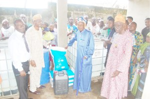 AMREC Officials presenting empowerment materials to the people of Isaga Orile Community