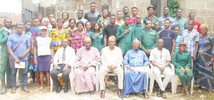 A group photograph of AMREC Officials with the Onisaga of Isaga, Orile, HRM, Olusoji Tella and his subjects at the programme