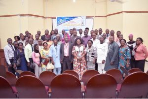 Principal Officers of the University, Resource Persons, Officials of CEADESE and participants in a group Photograph after the Workshop