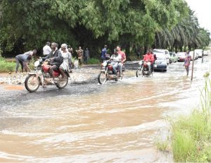 FUNAAB Zoo/FUNAAB Gate road over run by flood at the peak of the rainy season