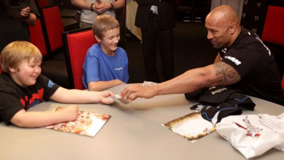 WWE Circle Of Champions Photos The Rock Grants Thomas Wish WWE Community